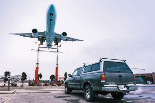 airplane-in-flight-over-pickup-truck-3536293